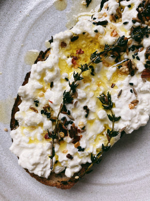 Cottage cheese toast with infused hot olive oil