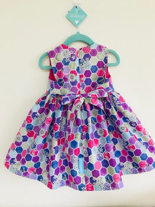 The Wishfairy Bunty Baby Dress (Bee Hexagons Pink)