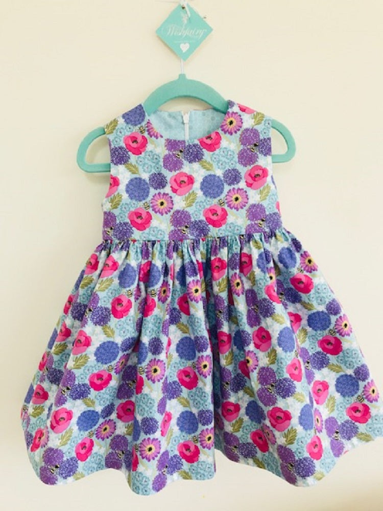The Wishfairy Bunty Baby Dress (Allium & poppies on blue)
