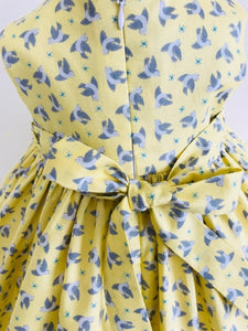 The Wishfairy Bunty Baby Dress (Flying Bluebirds on Lemon)