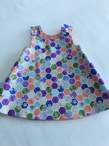 The Wishfairy Reversible Pixie Pinafore Baby Dress (Bee Hexagons on Green)