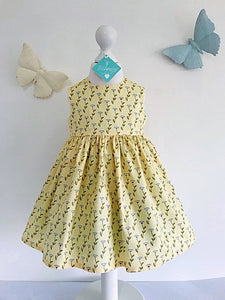 The Wishfairy Bunty Baby Dress (Daisies on Lemon)