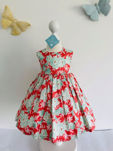 The Wishfairy Bunty Baby Dress (Mint Green Floral on Dark Coral)