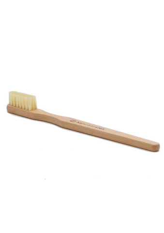 Toothbrush with natural bristles and wooden handle