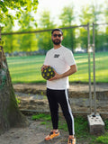 Omid is so fly in his original classic pannahouse white street soccer tee
