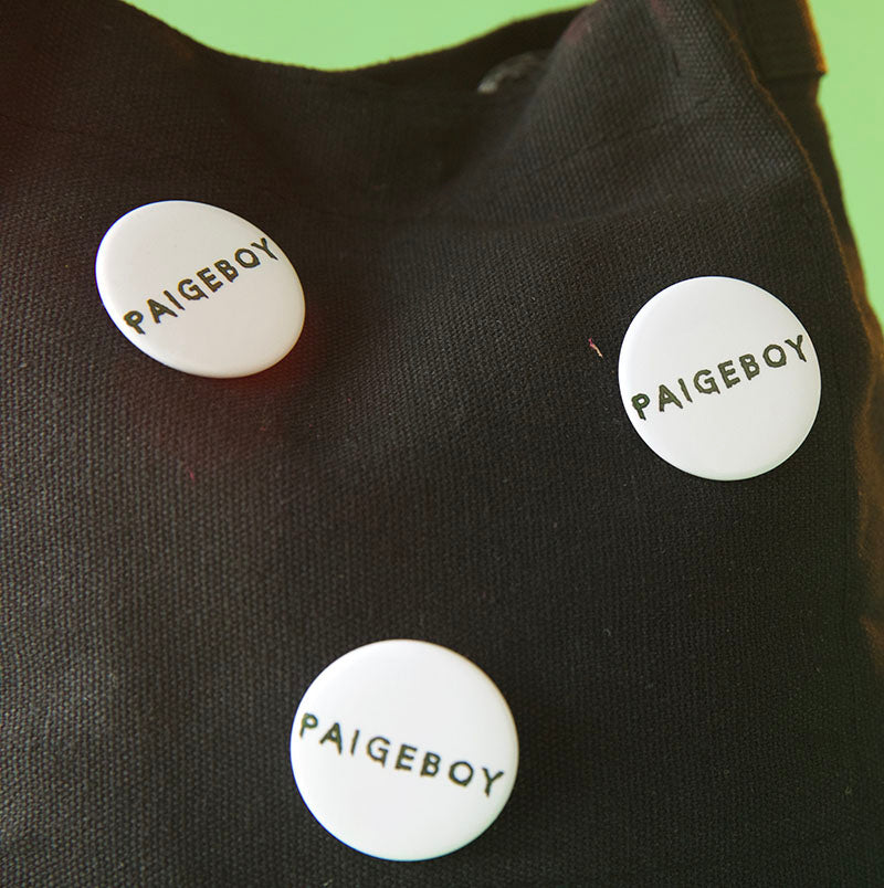 paigeboy logo button, paigeboy button, paigeboy, button, white button with black logo, white button, white paigeboy button