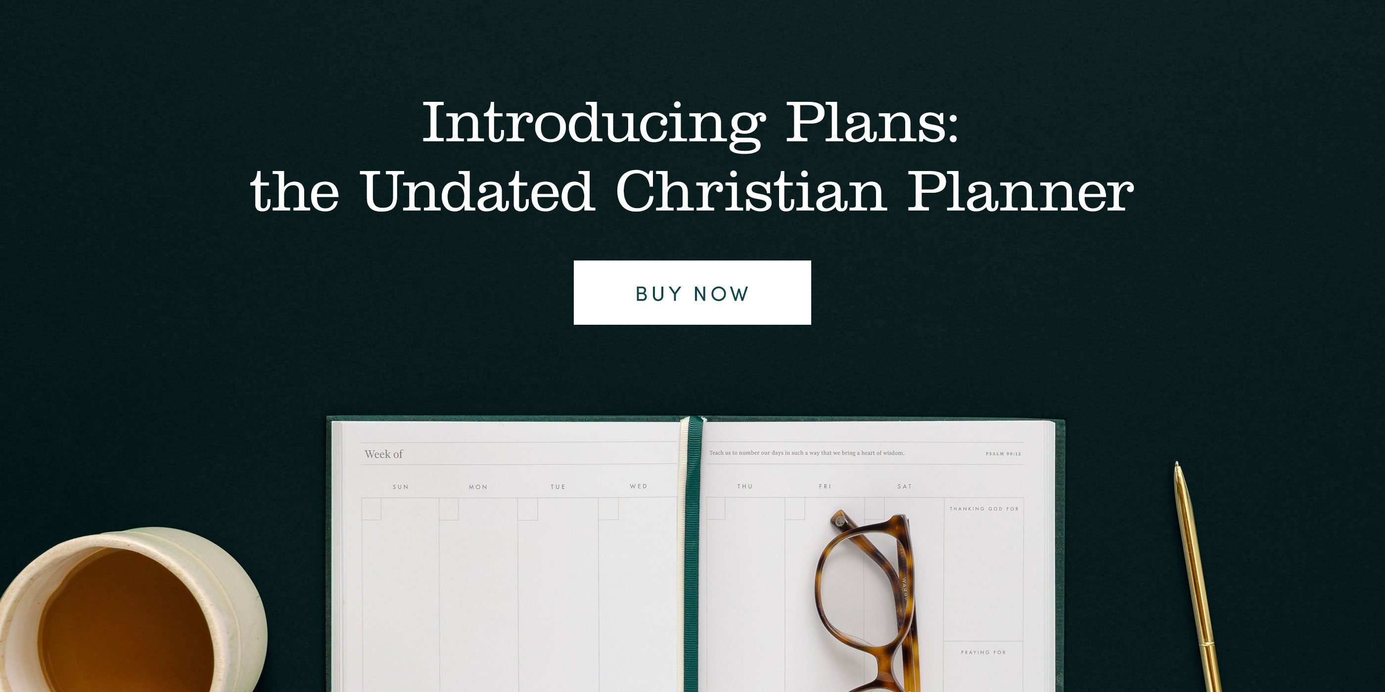Introducing Plans: the Christian Undated Planner. Desk scene with cup of coffee, open planner, glasses, and a brass pen.
