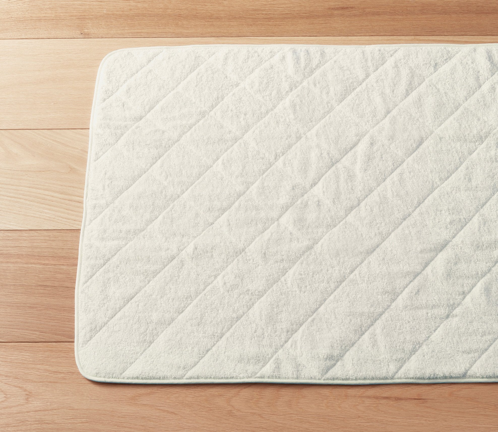 Cairo Quilted Bath Mat Ivory Product Image 1