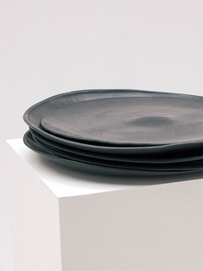 POL MAURI CARBONELL BLACK PLATE - Celestial - CELESTIAL - Sourced from artists in Europe, Asia and Africa, these limited edition pieces inspire a life of simplicity and style.