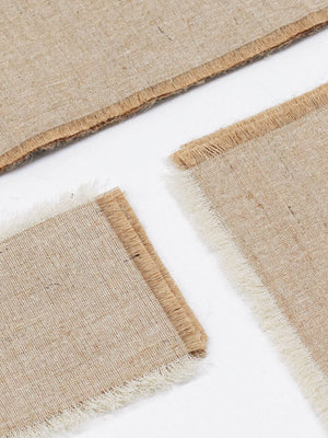 JUTE FRINGED MAT SET - C.W - CELESTIAL - Sourced from artists in Europe, Asia and Africa, these limited edition pieces inspire a life of simplicity and style.