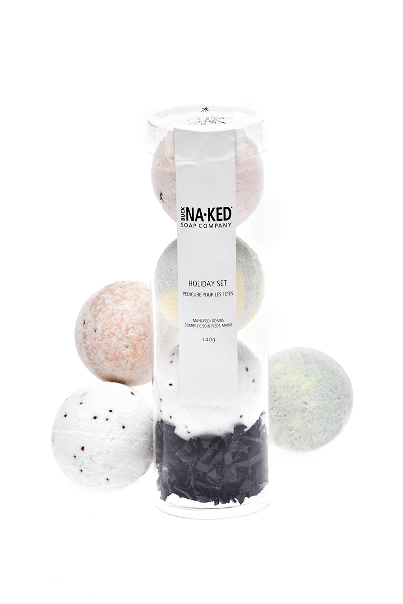 three small bath bombs in a tube
