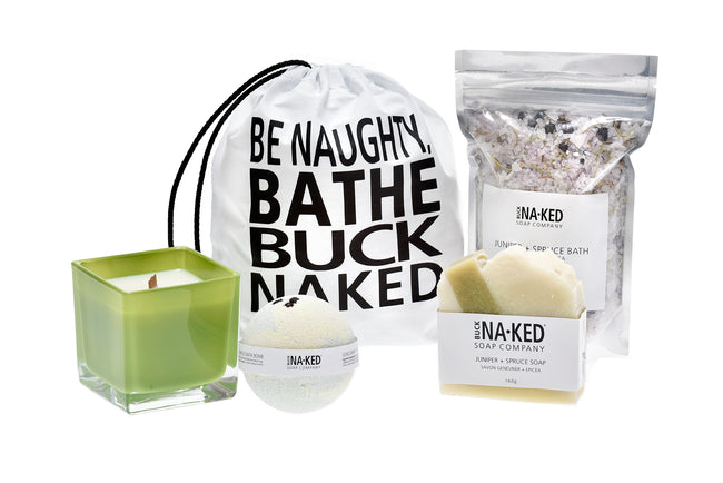 Juniper + Spruce Holiday Gift Set including bar soap, bath bomb, Dead Sea Bath Salt and candle in green container