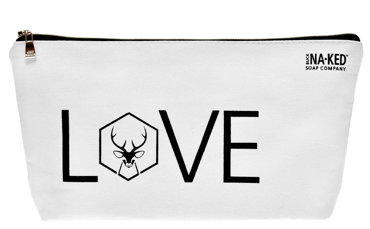white toiletries bag with the word love