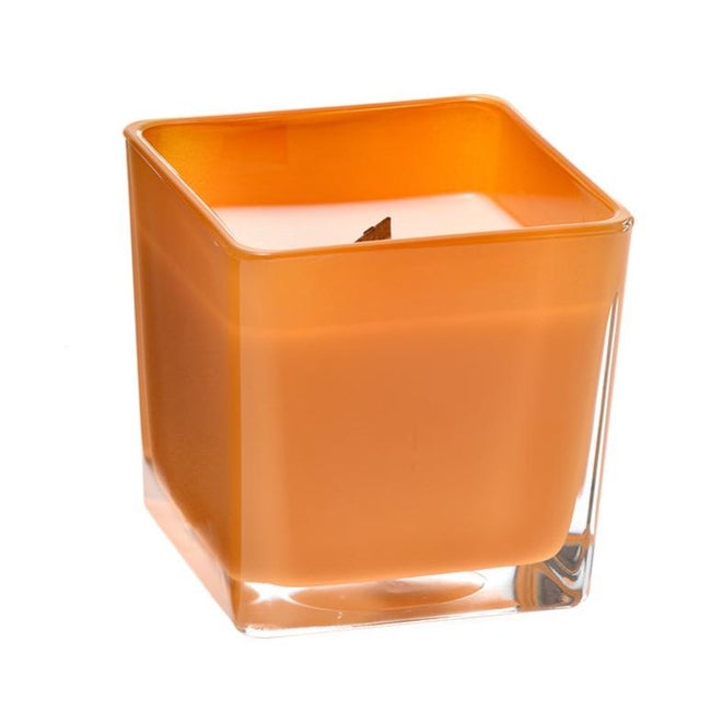 Grapefruit coconut wax candle in orange glass holder