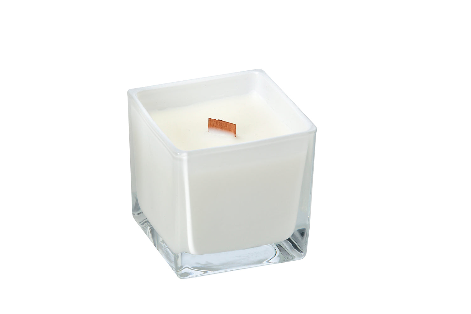 vaillia chai candle in a white glass container