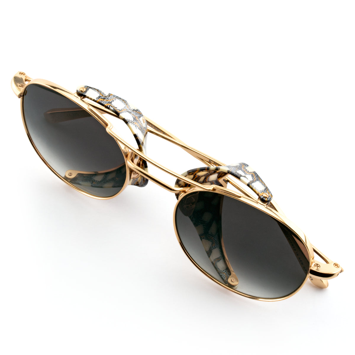 ORLEANS BLINKER | 24K Titanium + Stella - A seamless combination of premium metal and acetate side blinders for a truly modern pair of Sunglasses.