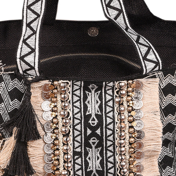 Close-up of hand beaded bucket style beach bag
