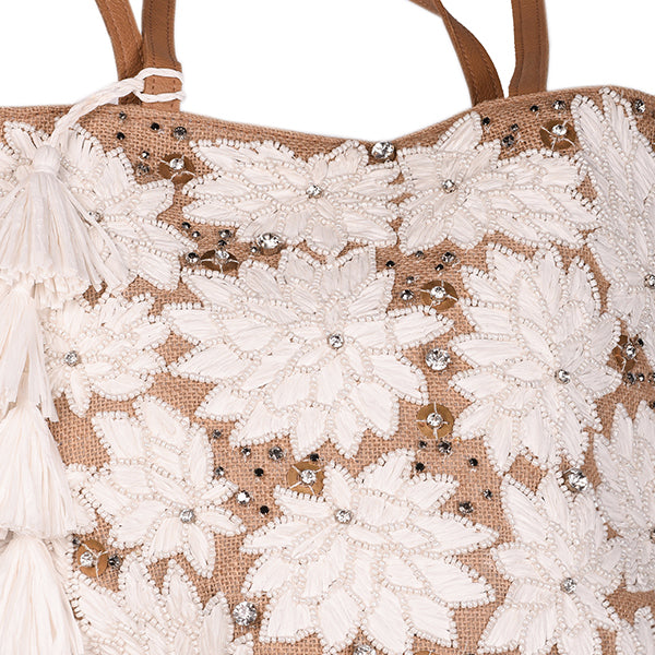 Close-up of hand beaded tote style beach bag