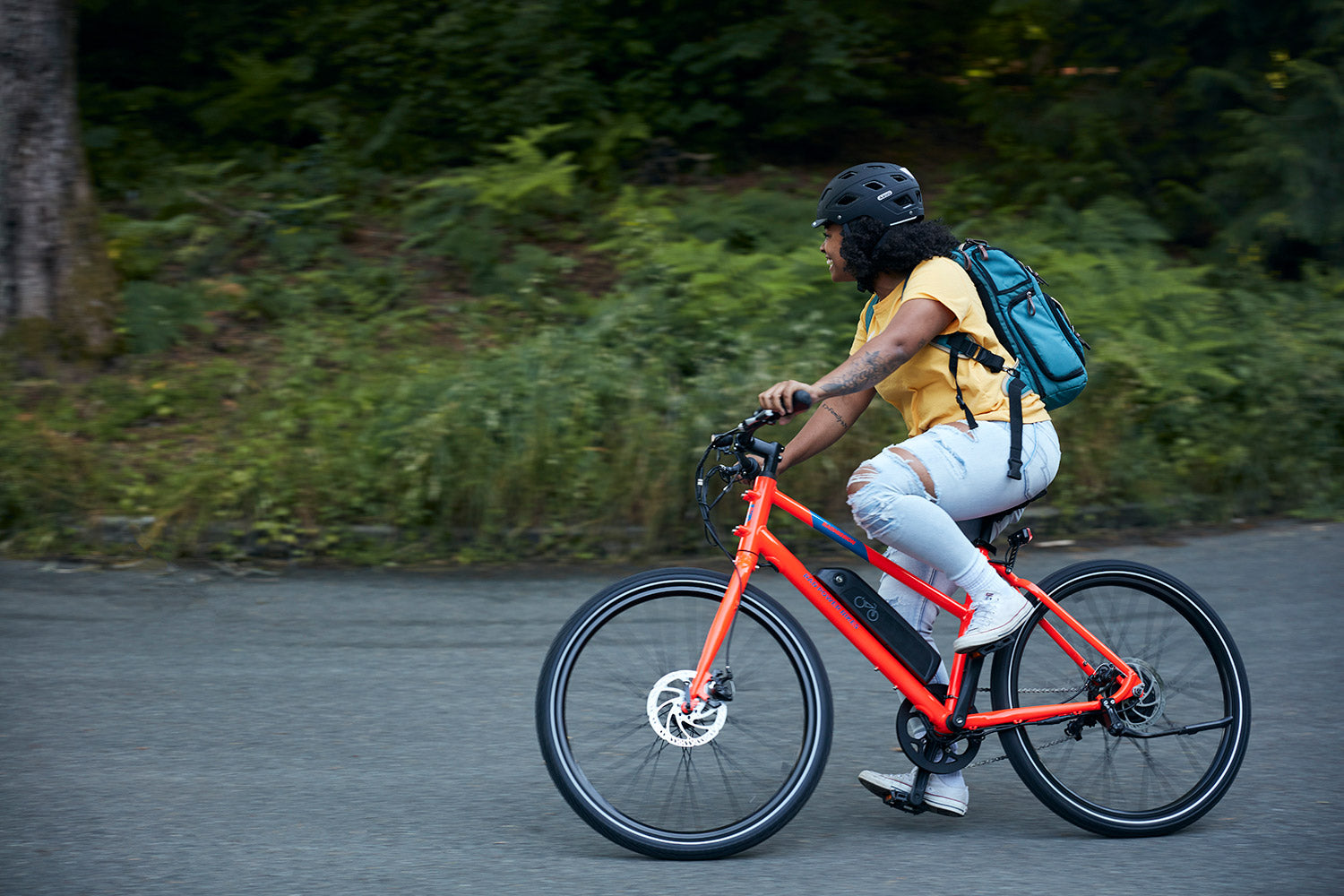 person riding red RadMission e-bike