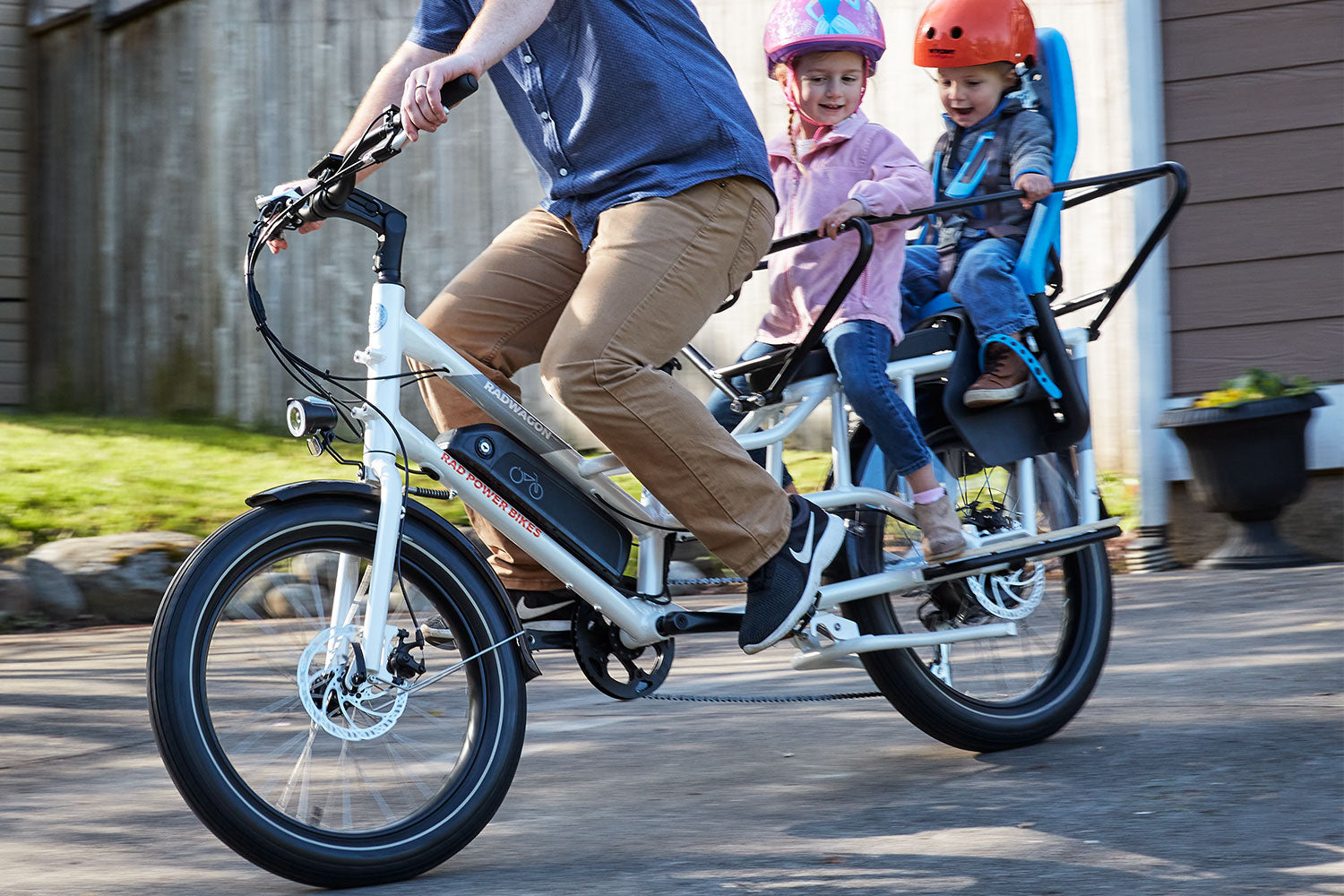 Kids riding on back of RadWagon 4 e-bike