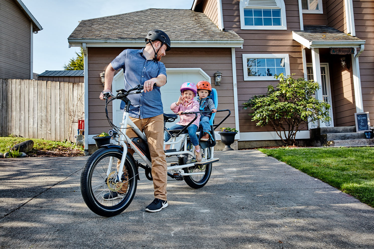 Dad with kids riding RadWagon 4 e-bike