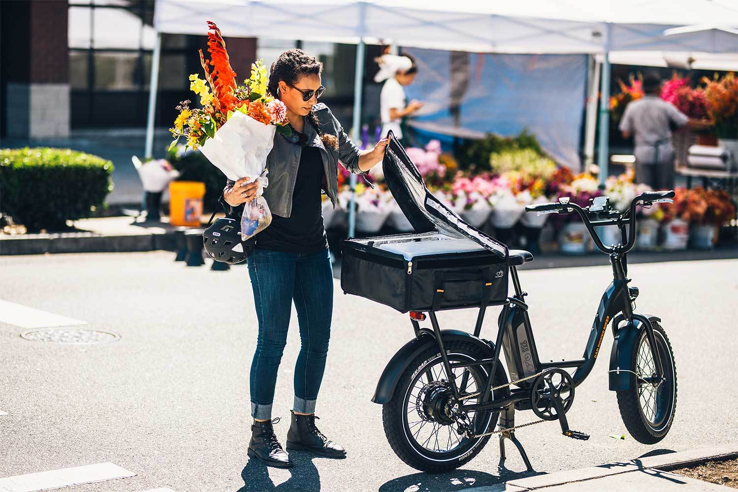 Person holding flowers with RadRunner e-bike