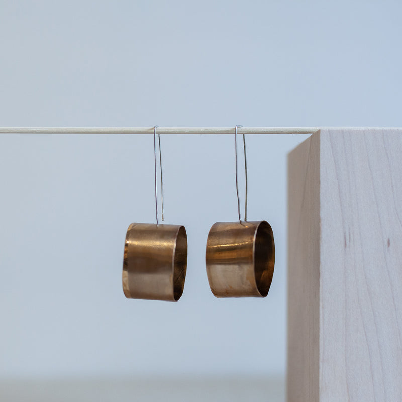 spect earrings bronze, sterling silver