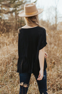 The Eve Peplum Top in Black