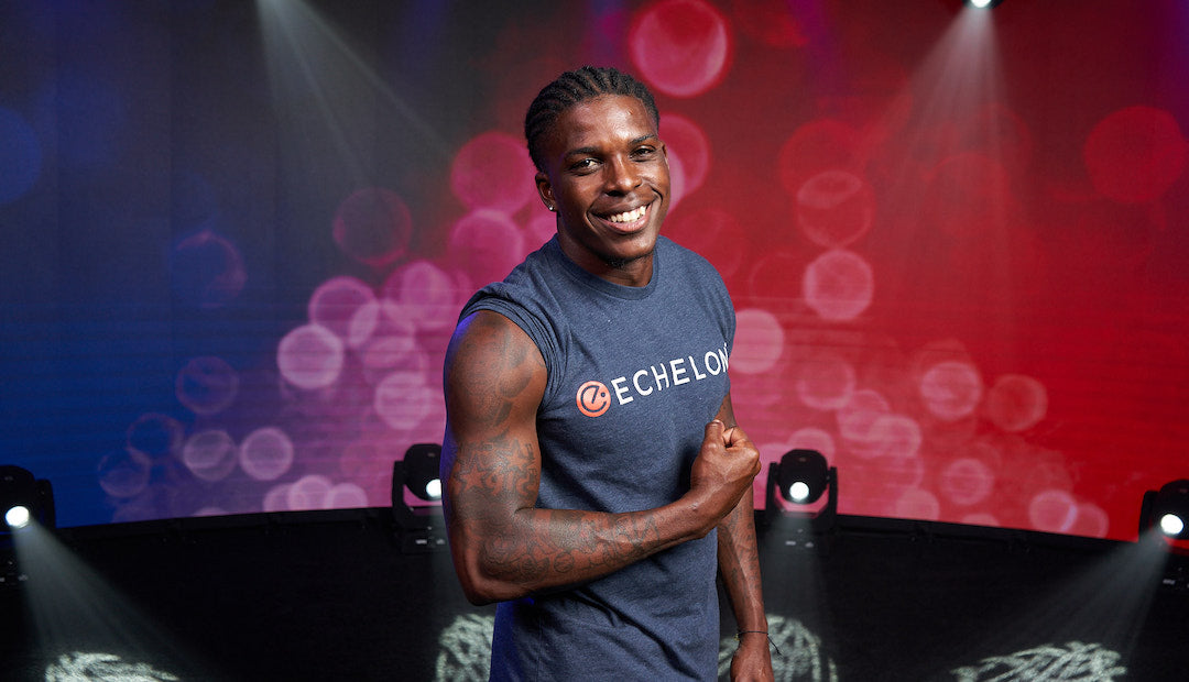 Guest Echelon Instructor Marvin Bracy flexes his arm and smiles