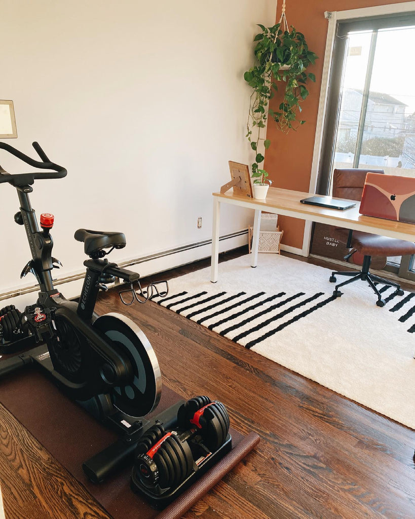 Echelon Connect bike in home office with cream and orange walls