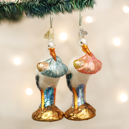 Baby's first Christmas ornaments - 2 storks bearing children