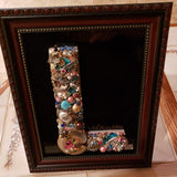 Jeweled letter L