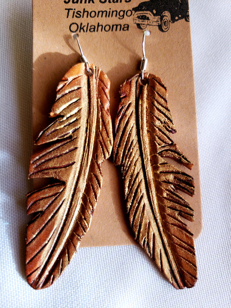 Gold dusted leather feather earrings
