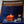 orange coffee and cigarettes dumpster fire candle