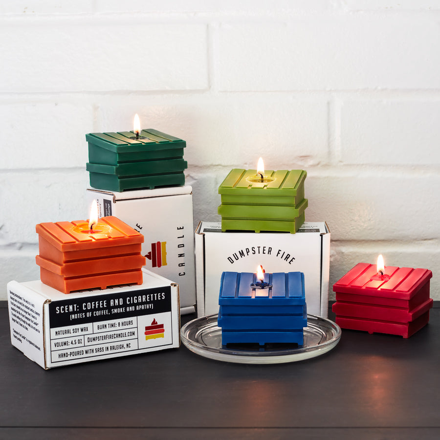 all five dumpster fire candles red green lime blue orange