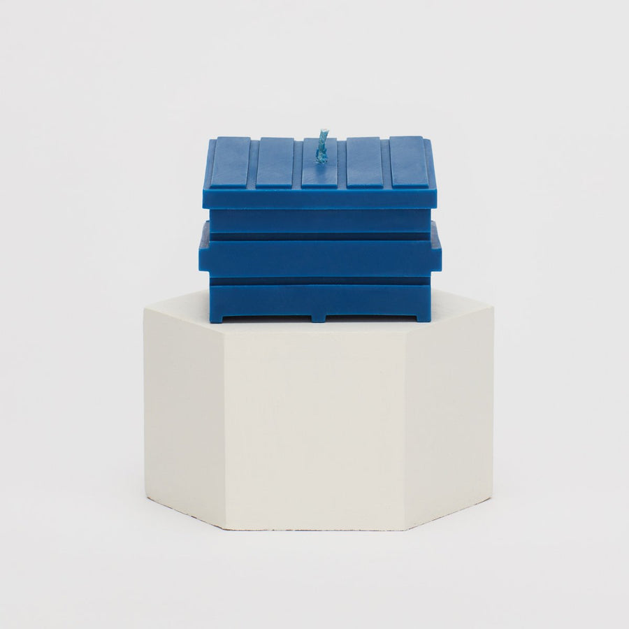 blue table for one dumpster fire candle