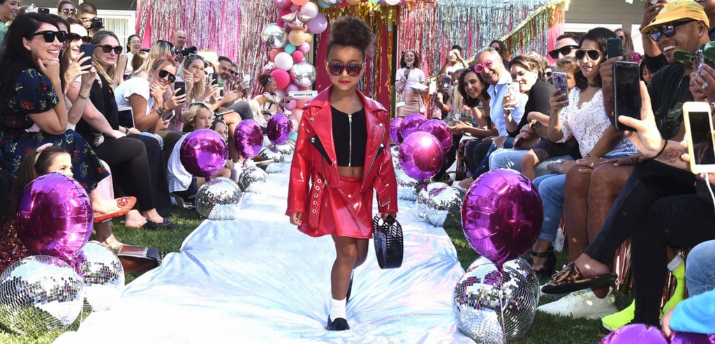 North West wearing Petite 'n Pretty makeup safe for kids at LOL Surprise fashion show