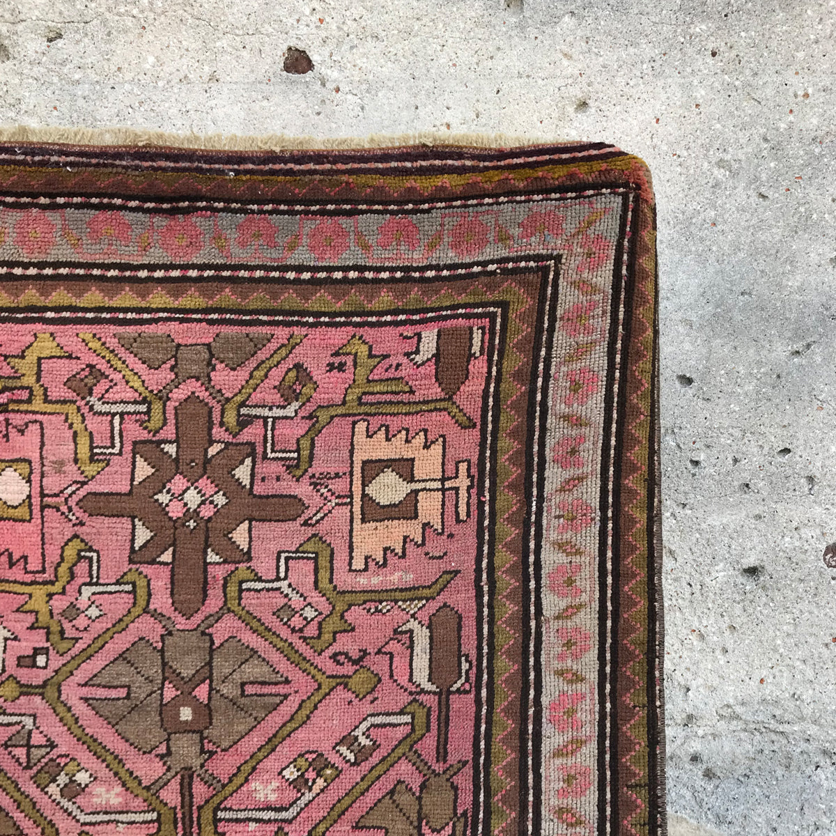 This vintage Turkish runner has an amazing pattern and texture. Pink is the main color with gray, olive and brown accents. 44x112 inches.