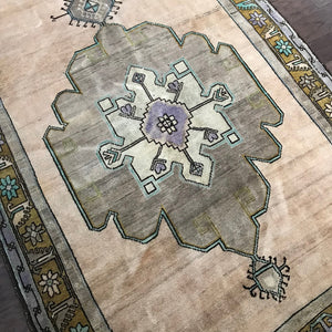 This rug is a luxurious and beautiful vintage Turkish rug. Teal, olive and periwinkle accents. Great size. 54x128.