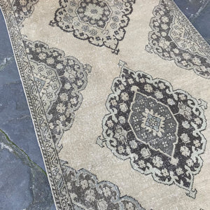 This handwoven vintage Turkish runner has beautiful, subtle blues and greens on the neutral field. 45.5 x 163 inches.