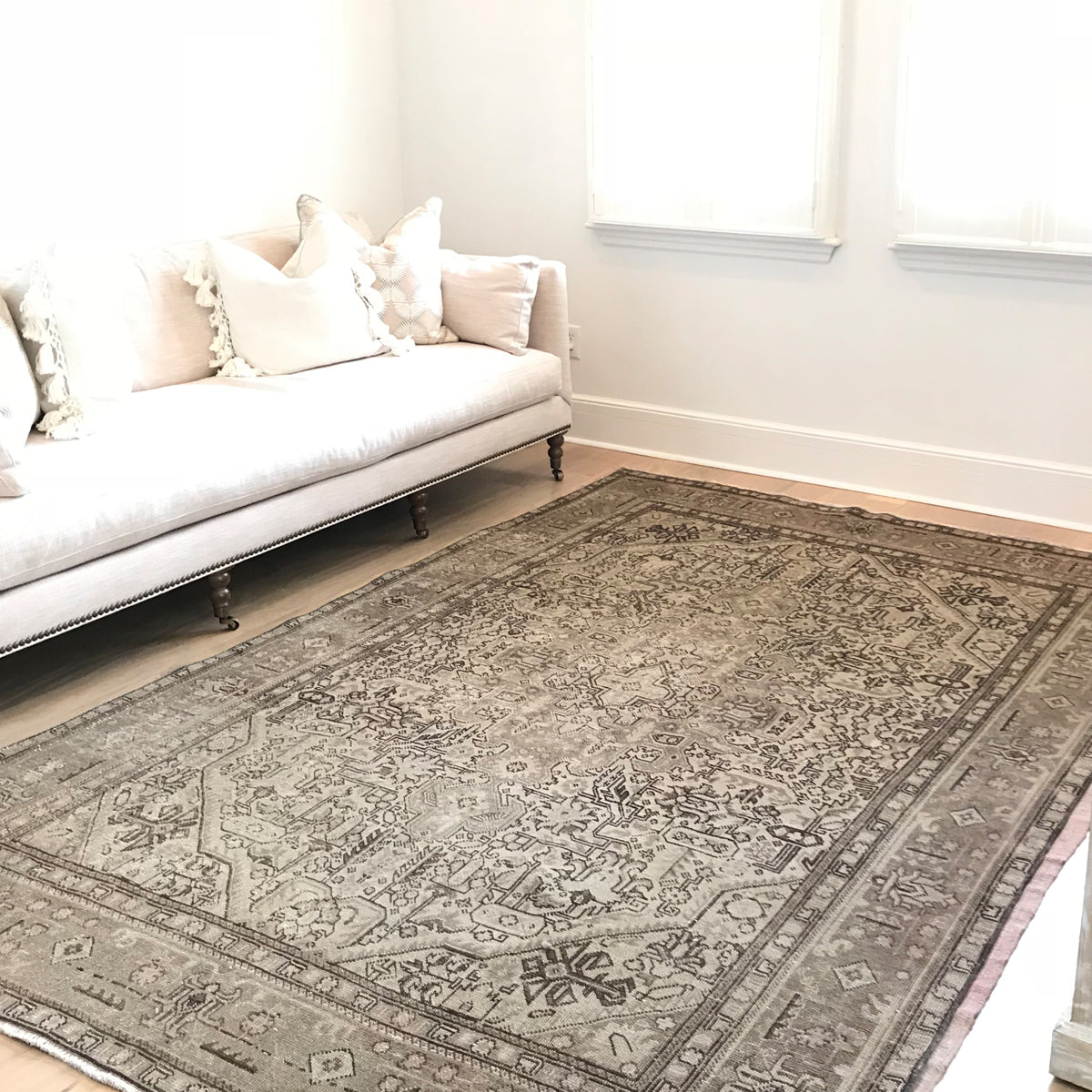 This vintage rug is Perisan and almost 7x9. There are subtle pops of pink throughout the design. 78x112 inches.