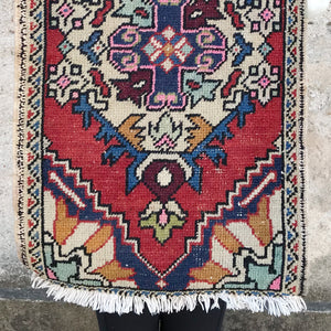 This small handwoven vintage Turkish rug is filled with fun colors and a beautiful design. 20 x 32 inches.