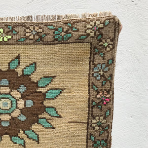 This small handwoven vintage Turkish rug has great colors and a fun floral design. Great for entryways, bathrooms, kitchens and layering. 22x37 inches.
