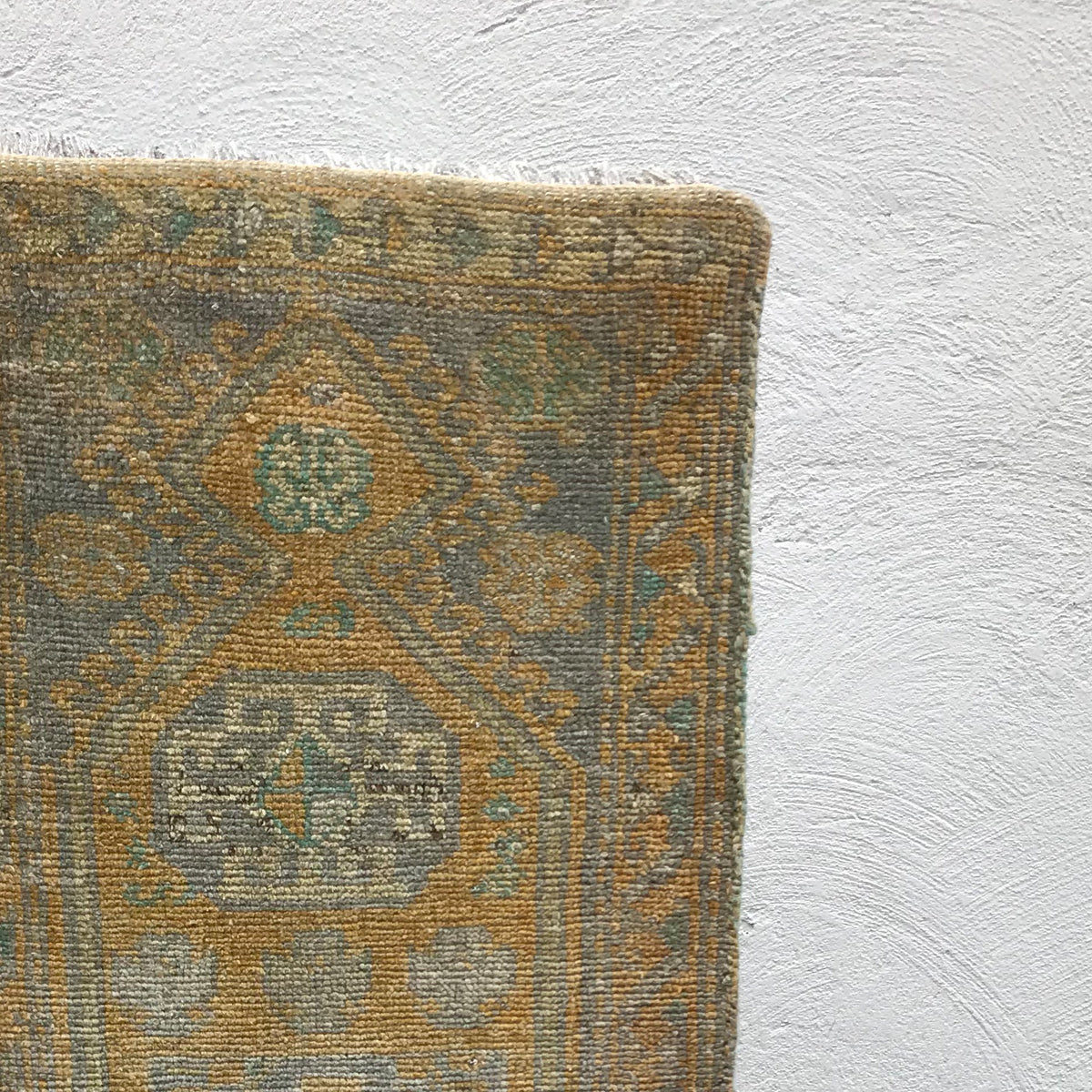 This small handwoven vintage Turkish rug has gorgeous blues and golds and is super soft! Great for entryways, bathrooms, kitchens and layering. 17x38 inches.