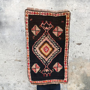 This vintage Turkish rug is small but bold and has an amazing pinks and peaches woven into the design. 20x30 inches.