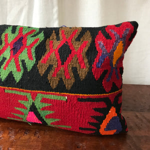 14x36 Kilim pillowcase made from recycled handwoven vintage Turkish kilims.  This lumbar size is looks great on a couch or a bed - solo or as a pair.  Zipper closure. Insert not included. Natural dyes. Wool. One of a kind.