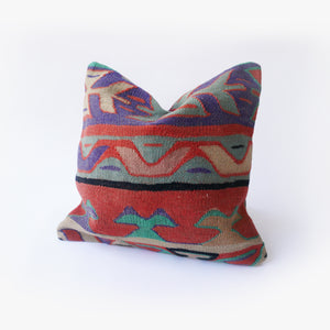 16x16 Kilim pillowcase made from recycled handwoven vintage Turkish kilims.  Zipper closure. Insert not included. Natural dyes. Colors include purple, red, teal, green, tan and black.