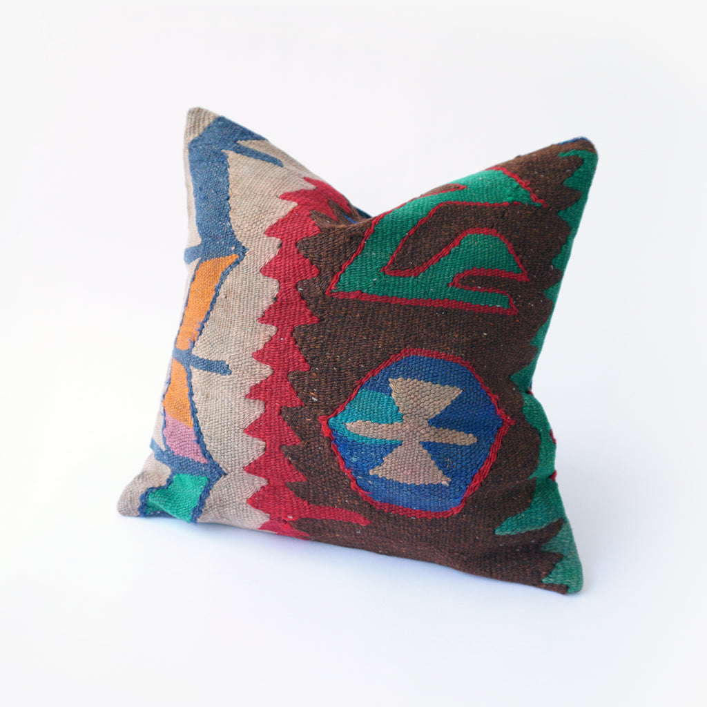 16x16 Kilim pillowcase made from recycled handwoven vintage Turkish kilims.  Zipper closure. Insert not included. Colors include brown, red, green, blue, gold, teal and tan.