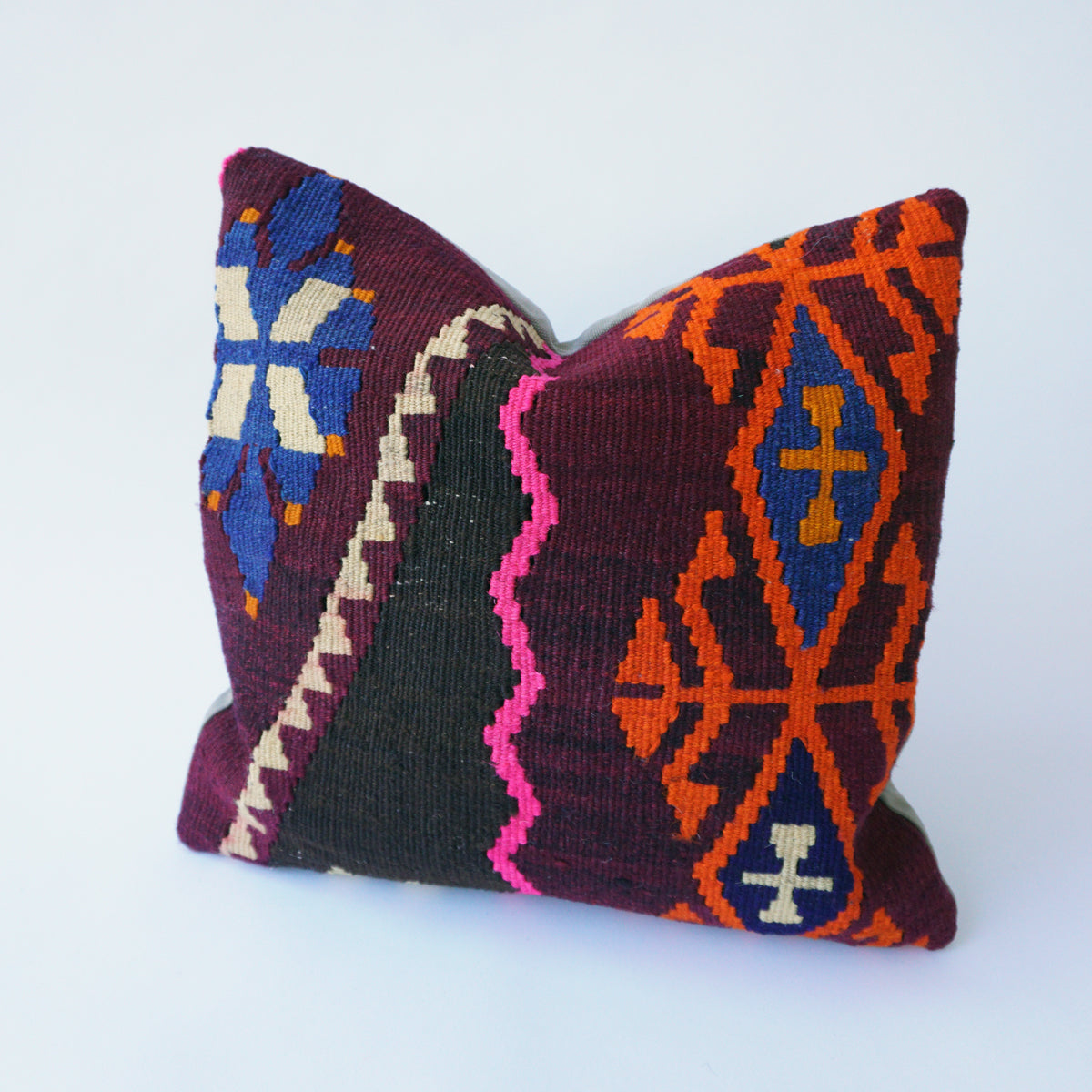 This pair of 16x16 Kilim pillowcases are cut from the same kilim rug.  Our pillowcases are made from recycled handwoven vintage Turkish kilims.  Zipper closure. Insert not included. Natural dyes. Wool. Each pillow is one of a kind.  Colors include olive, off white, salmon, gray and gold.