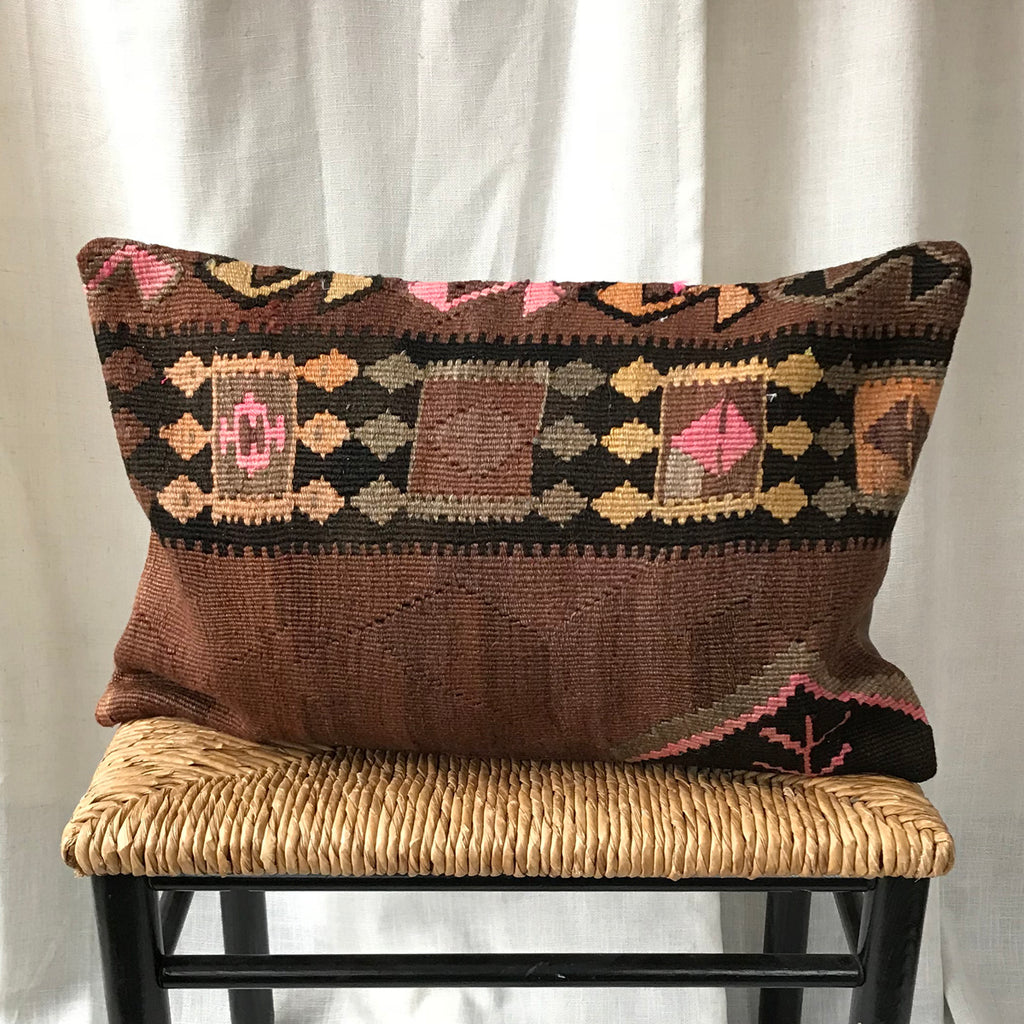 16x24 Kilim pillowcase made from recycled handwoven vintage Turkish kilims.  Zipper closure. Insert not included. Natural dyes. Wool. One of a kind.   Colors include off white, tan, pink, orange, light green, gold, lavender, brown and salmon.